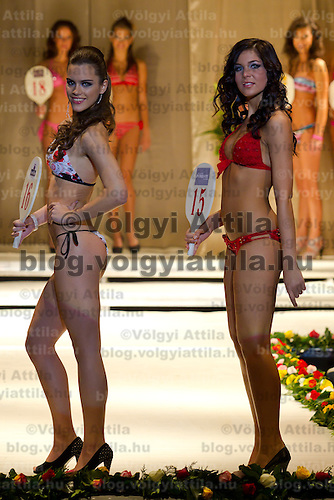 Timea Gelencser (left) and Alexandra Horvath (right) attends the Miss Hungary 2010 beauty contest held in Budapest, Hungary on November 29, 2010. ATTILA VOLGYI