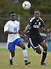Ward Melville No. 15 Brandon Nworjih, right, and North Babylon No. 18 Matias Danazar chase after a loose ball during a Suffolk County varsity boys' soccer Class AA first round playoff game at North Babylon High School on Tuesday, October 27, 2015. Ward Melville won by a score of 1-0.<br /> <br /> James Escher