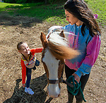 WOODBURY,  CT-052119JS05- Licia Leimarki shows her excitement as she met George, a pony and Nonnewaug High School student Ciara Taylor, as Mitchell Elementary School students got to  tour the Nonnewaug High School AG Department on Tuesday. <br /> Jim Shannon Republican American