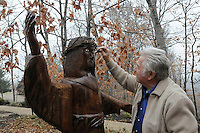 STAFF PHOTO FLIP PUTTHOFF <br /> CLINIC BLESSING<br /> Knapp does some touch-up work Dec. 2 2014 on his carving of Jesus Christ at Whitney Mountain Chapel near Garfield.