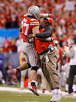 Ohio State Buckeyes defensive lineman Joey Bosa (97) gets a hug from assistant head coach Larry Johnson following a touchdown on a fumble recovery during the second quarter of the Big Ten Championship game against the Wisconsin Badgers at Lucas Oil Stadium in Indianapolis on Dec. 6, 2014. (Adam Cairns / The Columbus Dispatch)
