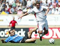 1 May 2004: Earthquakes Ramiro Corrales tackles the ball against Jaime Moreno at Spartan Stadium in San Jose, California.   DC United and Earthquakes tied 1-1..Mandatory Credit: Michael Pimentel/ISI