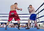 Heavyweight Zhang Zhilei from Henan Province, China, left, fights Curtis Lee Tate from Memphis Tenn. during the Rural Rumble on Friday night, August 8, 2014 at Churchill County Fairgrounds in Fallon, Nevada.