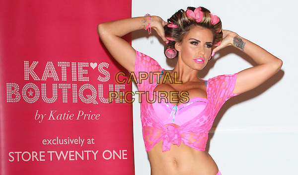 Katie Price (Jordan).The launch photocall for Katie Price's new summer lingerie range for Store 21, The Worx, London, England..May 29th, 2012.half length belly stomach midriff arms in air pink lace top bra cleavage rollers curlers in hair knotted lipstick .CAP/ROS.©Steve Ross/Capital Pictures.