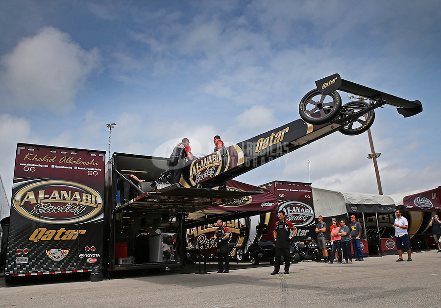 Apr. 26, 2013; Baytown, TX, USA: Crew members unload the car of NHRA top fuel dragster driver Khalid Albalooshi in the pits during qualifying for the Spring Nationals at Royal Purple Raceway. Mandatory Credit: Mark J. Rebilas-