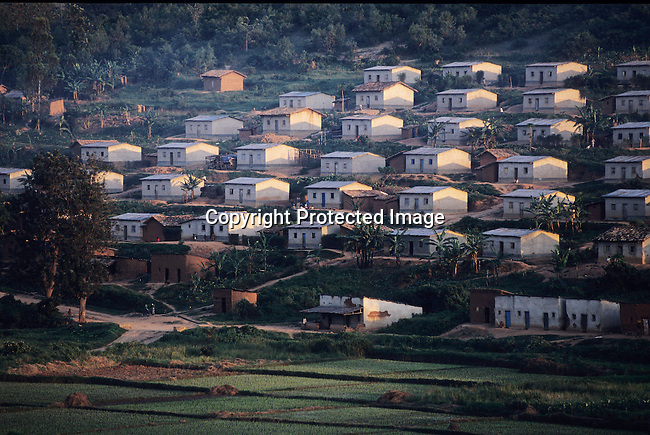 RWANDA - FEBRUARY 18: Houses in a development erected for survivors of the 1994 genocide, mainly housing women and children, sit in neat rows February 18, 2003 in a rural area close to Myaga, Rwanda. These houses were built with foreign funds all over the country to help victims and displaced people. 800,000 mainly Tutsis and moderate Hutus were killed in about one hundred days in Rwanda in 1994. About 100,000 prisoners accused of the genocide are still in prisons nine years later awaiting trials. Rwanda is currently trying to cope with these problems of crime, punishment and reconciliation through village trials called Gacacas. Gacaca, which means on the grass, is a traditional way of solving disputes between local communities and involve juries of residents. 11,000 gacacas are currently trying to resolve crimes from the genocide. (Photo by Per-Anders Pettersson)