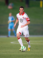 Conor Shanosky (17) of D.C. United brings the ball upfield during a third round match in the US Open Cup at City Stadium in Richmond, VA.  D.C. United advanced on penalty kicks after tying the Richmond Kickers, 0-0.
