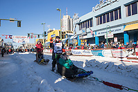 Ellen Halverson and team leave the ceremonial start line with an Iditarider and handler at 4th Avenue and D street in downtown Anchorage, Alaska on Saturday March 4th during the 2017 Iditarod race. Photo © 2017 by Brendan Smith/SchultzPhoto.com.