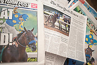 Headlines of New York newspapers on Sunday, June 7, 2015 report on American Pharoah winning the Triple Crown at Belmont Racetrack in New York.  (© Richard B. Levine)