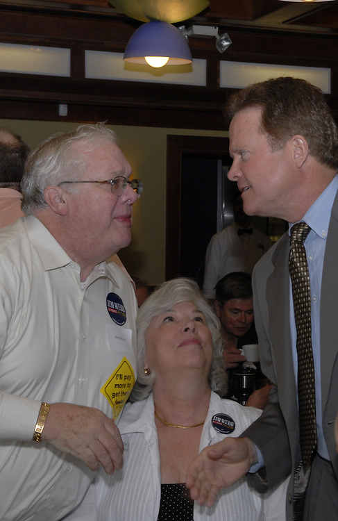 Jim Webb a Virginia U.S. Senate candidate greets Bob and Mary Anne Houis  before he spook at a breakfast at the Dulles Area Democrat's meeting in Herndon Virginia at the Amphora's Dinner Deluxe.