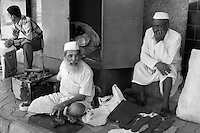 Mumbai, early mornong, maintown area, repairing shoes, a shoe repairman, Mumbai, India