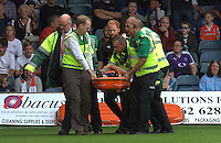 Luton Town captain Scott Cuthbert is strechered off with a suspected neck injury during the Sky Bet League 2 match between Luton Town and Doncaster Rovers at Kenilworth Road, Luton, England on 24 September 2016. Photo by Liam Smith.