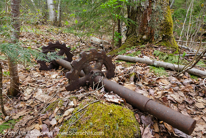 Mad River Logging Era - Artifact near the splash dam on Flume Brook in Waterville Valley, New Hampshire. This artifact is possibly part of the cut-up mill that was located in the area of logging Camp 5. Cut-Up Mills were used to cut logs into four foot lengths. From 1891-1946 +/-, this area was logged, and up until 1933 log drives were done on the Mad River to move logs down to Campton Pond.