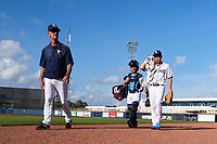Charlotte Stone Crabs pitching coach Steve Watson (left), catcher Zacrey Law, and starting pitcher Brendan McKay (right) walk to the dugout from the bullpen before a game against the Dunedin Blue Jays on June 5, 2018 at Charlotte Sports Park in Port Charlotte, Florida.  Dunedin defeated Charlotte 9-5.  (Mike Janes/Four Seam Images)