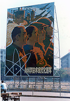 Propaganda poster showing workers in Canton.Pictures taken in Canton/Kwangchow China in 1977 at the time of the cultural revolution.