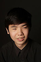Montreal, CANADA - 2014 Model released illustration photo.<br /> <br /> An asian male  teenager make funny faces and take selfie photo<br /> <br />  Photo : Agence Quebec Presse - Pierre Roussel
