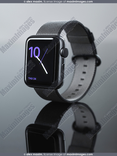 Apple Watch series 2 smartwatch with clock on its display isolated on gray background