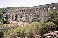 peloton over the ancient/famous aquaduct 'Pont du Gare'<br /> <br /> Stage 16: Nîmes to Nîmes(177km)<br /> 106th Tour de France 2019 (2.UWT)<br /> <br /> ©kramon