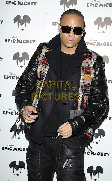 DJ IRONIK (Michael Laurence / James Charters).The Epic Mickey new Disney video game launch, Shoreditch Studios, New Inn Yard, London, England..October 28th, 2009.half length sunglasses shades black leather jacket red plaid tartan navy blue.CAP/CAN.©Can Nguyen/Capital Pictures.