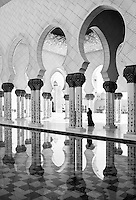 Abu Dhabi Mosque black and white image with woman walking in the arcades