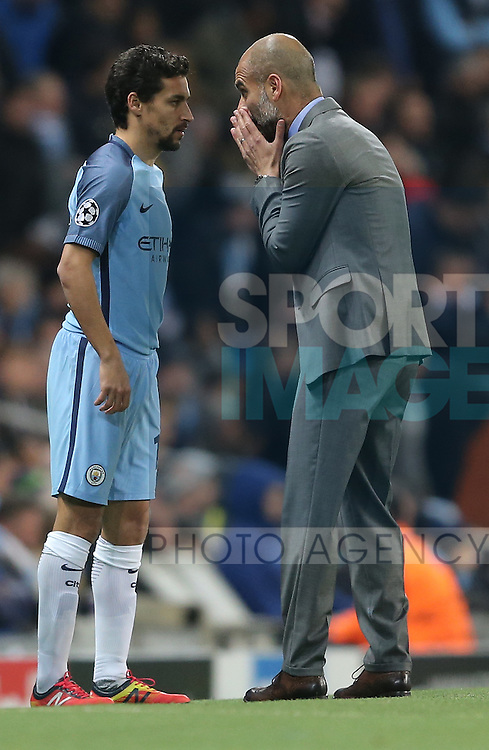 Jesus Navas of Manchester City is directed by Josep Guardiola manager of Manchester City during the Champions League Group C match at the Etihad Stadium, Manchester. Picture date: November 1st, 2016. Pic Simon Bellis/Sportimage