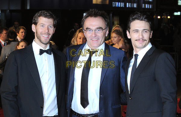 "ARON RALSTON, DANNY BOYLE & JAMES FRANCO .Attending The European Premiere of ""127 Hours"" during the closing gala of the 54th BFI London Film Festival, Odeon Leicester Square, London..28th October 2010.LFF half length tuxedo tux blue jacket suit glasses smiling black suit tie white shirt  facial hair moustache mustache .CAP/BEL.©Tom Belcher/Capital Pictures."