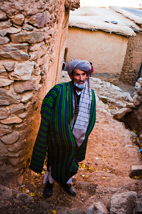 Village elder in Panjshir valley wearing the traditional Chapan coat.