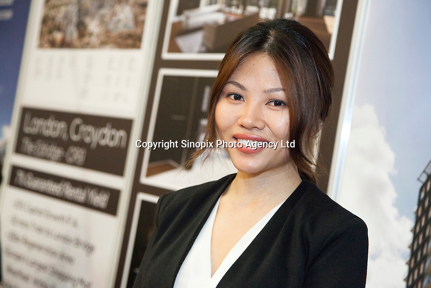 Zoe Jiang, business develop manager of Sloan International Development at the Smart International Property Investment Expo at the Hong Kong Convention and Exhibition Centre in Hong Kong. <br /> 07-08 June, 2014<br /> <br /> Photo by Tim O'Rourke / Sinopix