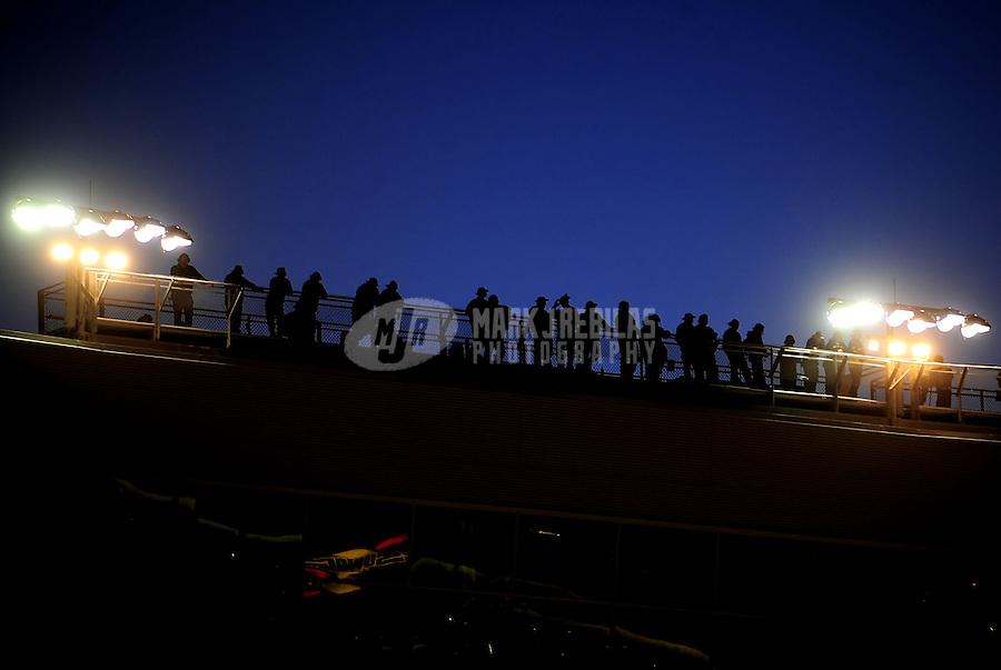 Apr 16, 2009; Avondale, AZ, USA; NASCAR Camping World Series West spotters watch from the spotters stand during the Jimmie Johnson Foundation 150 at Phoenix International Raceway. Mandatory Credit: Mark J. Rebilas-