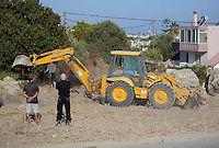 Pictured: DI Jon Cousins of South Yorkshire Police (R) watches on as a digger assists with the preliminary search at the new site in Kos, Greece. Friday 07 October 2016<br />Re: Police teams led by South Yorkshire Police, searching for missing toddler Ben Needham on the Greek island of Kos have moved to a new area in the field they are searching.<br />Ben, from Sheffield, was 21 months old when he disappeared on 24 July 1991 during a family holiday.<br />Digging has begun at a new site after a fresh line of inquiry suggested he could have been crushed by a digger.
