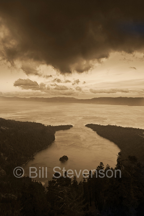 An image of Emerald Bay and storm clouds from the top of Maggie's Peak.