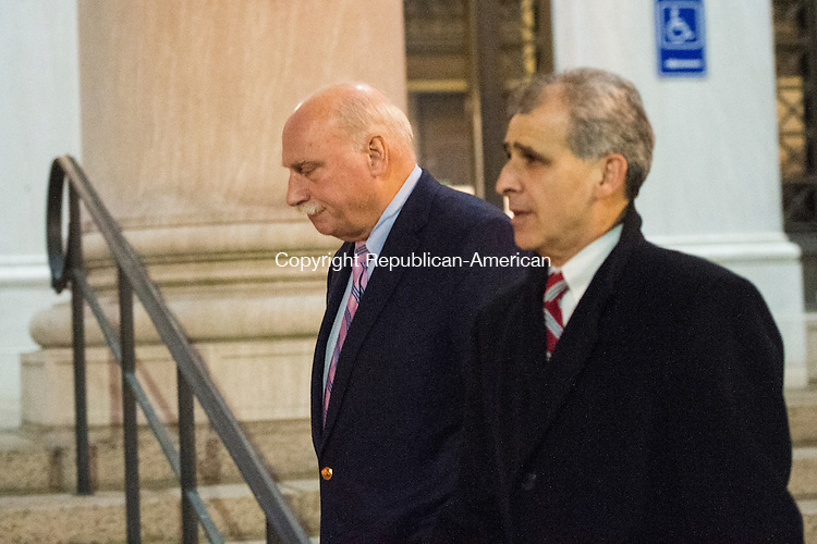 NEW HAVEN, CT- 13 January 2015-011316EC04-    Peter Clark (L) walks out of the federal courthouse in New Haven Wednesday with his attorney, William Stevens. Clark was sentenced 3 years, 9 months in prison for stealing $1.8 million from a woman who left money to Oxford. Erin Covey Republican-American