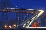 April's full moon rising over the San Rafael Richmond Bridge.