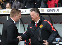 SWANSEA, WALES - FEBRUARY 21: L-R Swansea manager Garry Monk greets Manchester United manager Louis Van Gaal prior to the Barclays Premier League match between Swansea City and Manchester United at Liberty Stadium on February 21, 2015 in Swansea, Wales.