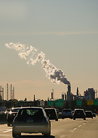 CARTERET NEW JERSEY, NJ - NOVEMBER 17: Vehicles move along the The New Jersey Turnpike Way while a Factory emits smoke on November 17, 2017 in New Jersey. United States still contributing to the global greenhouse gas emissions as the Trump Administration have dismantled the U.S. foreign-policy to reduce carbon pollution, political divisions in the United States over climate change spilled over to the outside world has been seen at the COP23 United Nations Climate Change Conference that ends today in Bonn, Germany (Photo by Kena Betancur/VIEWpress/Corbis via Getty Images)