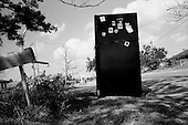 New Orleans, Louisiana.May 26, 2006..A black refrigerator discarded in the streets of east New Orleans.