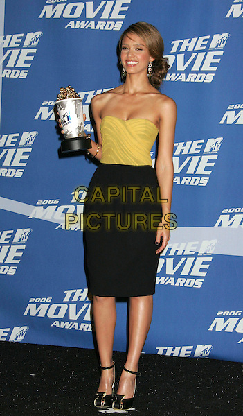 JESSICA ALBA.The 2006 MTV Movie Awards - Press Room, Culver City, California, USA..June 3rd, 2006.Photo: Russ Elliot/AdMedia/Capital Pictures.Ref: RE/ADM.full length award trophy strapless mustard yellow top black pencil skirt .www.capitalpictures.com.sales@capitalpictures.com.© Capital Pictures.