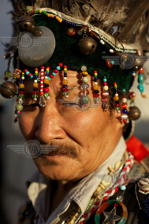Shaman Lazo Mongush, 61, performs a shamanic dance at his home in Kyzyl, capital of Tuva Republic, southern Siberia, Russia. Isolated from air and train transport, the population of Tuva retains a strong sense of traditional spiritual culture.