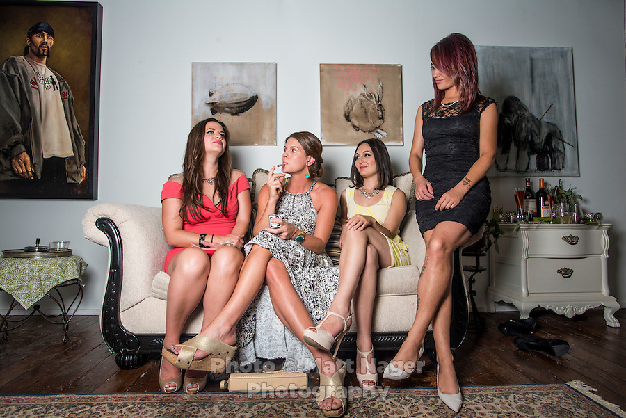 From left to right, Olivia Mannix, Jane West, Jennifer DeFalco and Megan Leigh Page at smoke a joint at a cannabis after party in Denver, Colorado, Sunday, July 20, 2014. <br /> <br /> Photo by Matt Nager