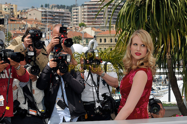 "LUCY PUNCH.""You Will Meet a Tall Dark Stranger' photocall during the 63rd International Cannes Film Festival, Cannes, France, .15th May 2010..half length dress  red lipstick make-up pink floral flowers print side photographers press .CAP/PL.©Phil Loftus/Capital Pictures."