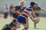 S. Pole looks for support as he is tackled by D. Butcher. CMRFU Counties Power Premier Club Rugby game between Patumahoe & Pukekohe played at Patumahoe on April 12th, 2008..The halftime score was 10 all with Pukekohe going on to win 23 - 18.