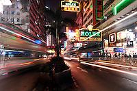 Tarffic speeds at night along Nathan road in Tsim Sha Tsui, Hong Kong. Nathan Road is the main thoroughfare in Kowloon, Hong Kong that goes in a south-north direction from Tsim Sha Tsui to Mong Kok..30 Oct 2007