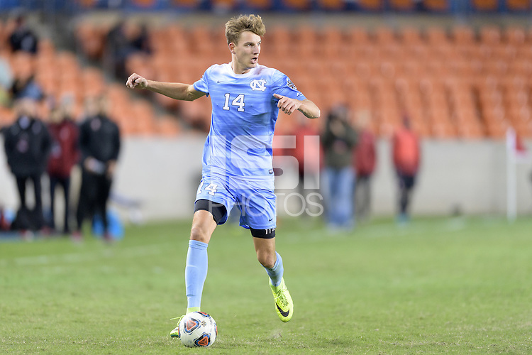 Houston, TX - Friday December 9, 2016: Nils Bruening (14) of the North Carolina Tar Heels brings the ball up the field against the Stanford Cardinal at the NCAA Men's Soccer Semifinals at BBVA Compass Stadium in Houston Texas.