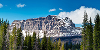 Snow is still present on the mountains on a bright, crisp summer day in the Shoshone National Forest in Wyoming.