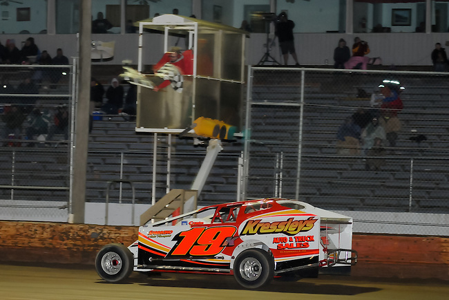Brett Kressley takes the checkered flag on the 2012 opening night at Bridgeport Speedway