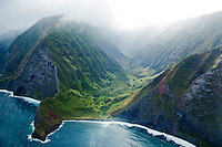 An aerial shot of Waikolu Valley on Moloka'i; clouds fade into the distance of a beautiful lush valley.
