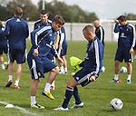 David Goodwillie nutmegs Kenny Miller at Scotland training