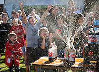 Bottles of cola erupt into fountains as Mentos candies react with the soda during Discovery Days at the Sonoma County Fairgrounds, in Santa Rosa, Calif., on October 26, 2013. (Alvin Jornada / The Press Democrat)