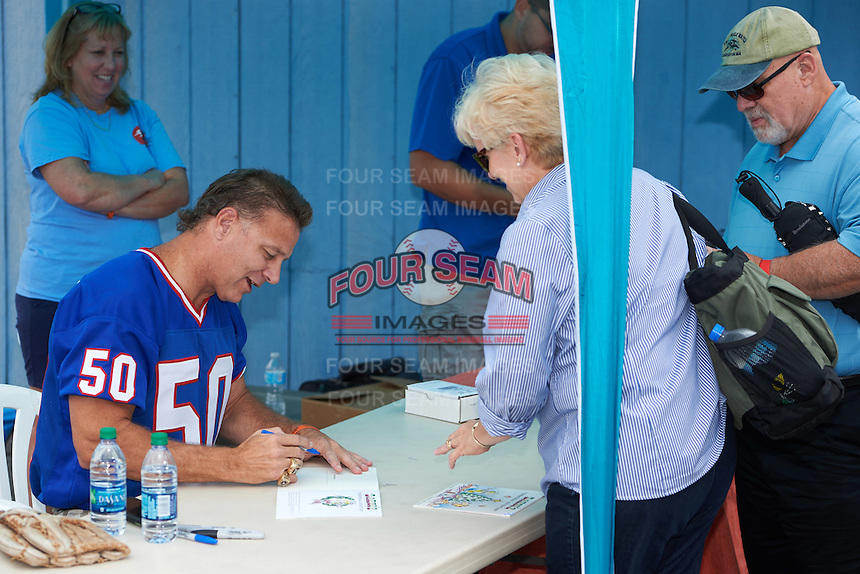 Former Buffalo Bills linebacker Ray Bentley signs autographs before a Batavia Muckdogs game against the West Virginia Black Bears on August 21, 2016 at Dwyer Stadium in Batavia, New York.  West Virginia defeated Batavia 6-5. (Mike Janes/Four Seam Images)