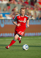Toronto FC defender Richard Eckersley #27 in action during an MLS game between the Seattle Sounders FC and the Toronto FC at BMO Field in Toronto on June 18, 2011..The Seattle Sounders FC won 1-0.